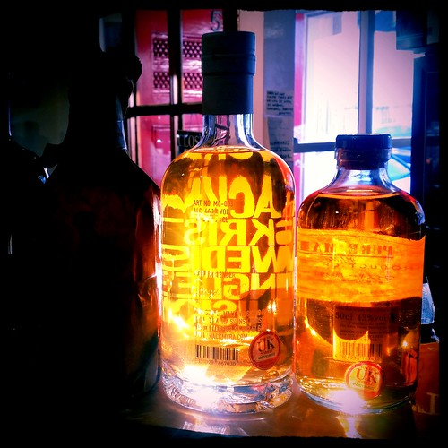 Swedish and Japanese Whisky Bottles with sunlight coming through them