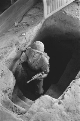 Hậu Nghĩa 1966 - Operation Crimp, 3rd Brigade, 1st Infantry Division. Iron Triangle, Cu Chi district. U.S. soldiers exploring Vietcong cave.