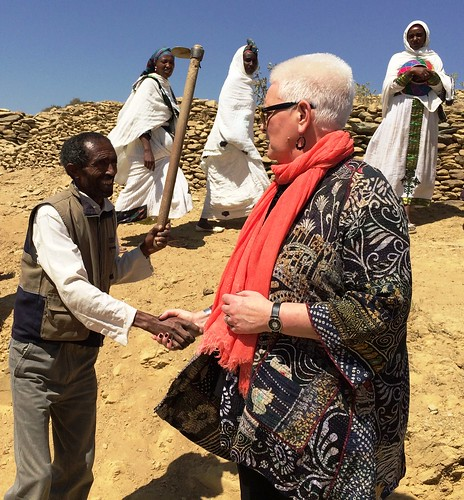 A PSNP beneficiary welcomes USAID's Administrator Gayle Smith to the Gamad watershed.