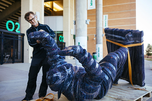 0927 Brian Hanlon opens the newly-arrived Joe Green sculpture