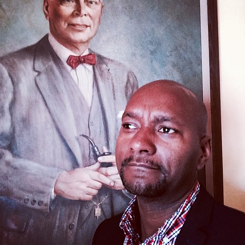 Posing in front of the portrait of Dalt Wisney.  #atwork
