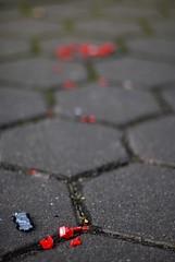 Trail of Blood (Andr Hofmeister) Tags: red rot broken 50mm nikon pavement hamburg toycar kaputt brgersteig spielzeugauto afnikkor50mm114d feldstrase