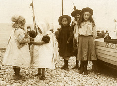 Edwardian children on the beach (lovedaylemon) Tags: sea holiday beach vintage found boat seaside sand child image pebbles edwardian pinafore spade