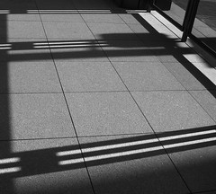 commutes 60208 016 (james in balto) Tags: city shadow urban blackandwhite sun window lines sunshine tile square spring downtown angle geometry baltimore sidewalk shade parallelogram baltimorecity