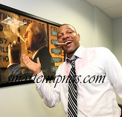 doc rivers posing with a picture of red