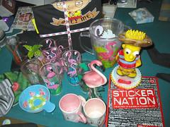 20071226 - Christmas Presents - 146-4651 - SubGenius book, plasma mug, flamingo dishes, Family Guy pajamas, Bart Simpson, sticker book