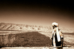 The Walk (From Afghanistan With Loveّ) Tags: world travel afghanistan sepia digital canon walking eos rebel beads kiss walk muslim culture rosary stick vest turban 2008 zeerak saarc xti safrang hamesha javaid samangan