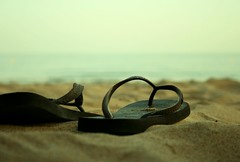 Sand, Sea and Slippers (Sandra_R) Tags: ocean sea macro beach portugal water closeup evening sand marine exterior dusk havaianas algarve slippers sss albufeira blueribbonwinner littlemisspatriciasactions praiasantaluísa