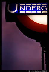London Underground Roundel Sign (jerseyimage) Tags: greatbritain light england color colour london sign closeup underground logo outside outdoors evening lowlight metro dusk tube illuminated september explore crop signage 2008 section verticle roundel partof