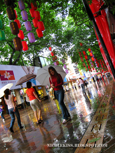 standing in rainy guangzhou