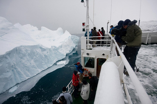 Climate-aware artists and crew look on at Ilulissat Kangia icebergs in Greenland