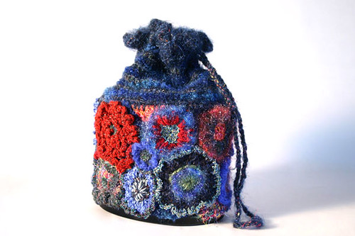 Drawstring bag with crochet motifs stitched to 'leaf-guard' mesh