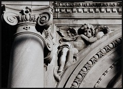 Detail: Ionic Capital and Cherub, Hurlbut Memorial Gate--Detroit MI (pinehurst19475) Tags: city urban architecture angel shadows architecturaldetail michigan stonework capital detroit cherub column elegant architects ionic elegance ioniccapital beauxarts architecturaldetails pentaxmzm urbanfragment puredetroit nationalregister fuji400film blackandwhitephotos nationalregisterofhistoricplaces columncapital eastjefferson nrhp sculpturalrelief egganddart hurlbut mihistoricsite eastjeffersonavenue nrhpstructure75000967 pinehurst19475 hurlbutmemorial chaunceyhurlbut hurlbutmemorialgate bredeandmueller gustaveamueller gustavemueller hermanbrede hermanabrede gustavmueller hurlbutgate bredemueller