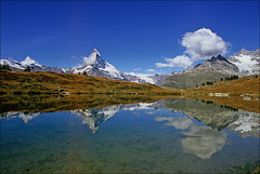 leisee (Ron Layters) Tags: leica mountain lake reflection clouds switzerland interestingness interesting slide bluesky explore velvia valley transparency zermatt matterhorn fujichrome wallis valais 1k sunnegga mountainsalps obergabelhorn elevation40004500m altitude4478m summitmatterhorn leicar3 specland mattertal ronlayters leisee slidefilmthenscanned clichedshot cmwdblue untergabelhorn wellenkuppejust theesalwaysclouds findelnalp highestpositioninexplore47ontuesdaynovember42008