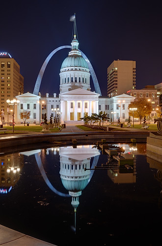 Old Courthouse and Gateway Arch, in downtown Saint Louis, Missouri, USA - view at night with reflection