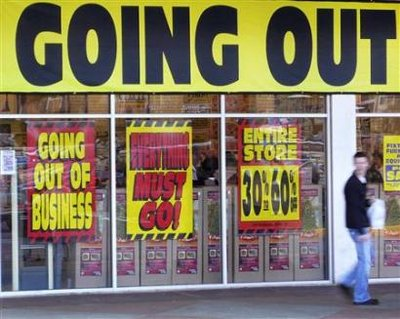 A man walks past a store advertising a sale, on 'Black Friday' ... - Yahoo! New