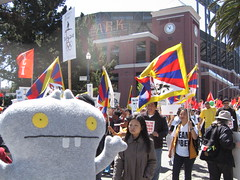 Traveling Babo checks out the 2008 Beijing Olympic Torch Relay (Protest) in San Francisco. (travelbabo) Tags: sanfrancisco china protest beijing tibet flame torch olympic olympics darfur beijing2008 uglydolls babo olympictorch summerolympics 2008olympics travelingbabo
