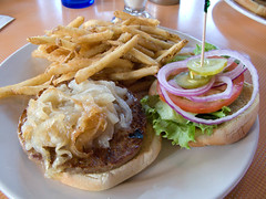 Vegan burger with grilled onions and fries