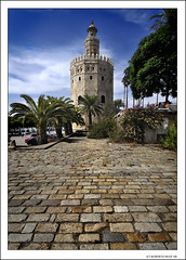 5 Postcards from Sevilla... 3rd: 'Torre del Oro' (Golden Tower) (B'Rob) Tags: city travel blue light sky espaa streetart color tower art tourism true azul photography gold golden photo yahoo google sevilla spain nikon flickr torre postcard picture tourist colores seville andalucia best palm explore cielo wikipedia eden palmera oro mejor tradicin d300 adoquin 18200mm brob explored gettyimagesspainq1 brobphoto