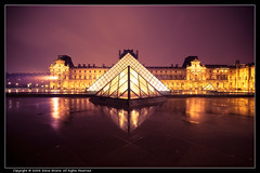 Rainy Night at the Cour du Louvre (David Briard) Tags: longexposure paris france alps reflection rain night court outside pyramid pentax louvre tripod pluie sigma beam explore reflet rayon polarizer extrieur nuit iledefrance pyramide cour aficionados longueexposition coolshot polarisant trpied 10faves explored k10d pentaxk10d davidbriard 1020mmf456dcex francesmasterpieces