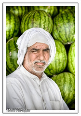 Watermelon Man (Khalid AlHaqqan) Tags: hairy man green vegetables canon beard market watermelon kuwait melon khalid shuwaikh 70200mm 40d kuwson alhaqqan ahwazi nostrobistinfo haqqan shuwaikhvegetablesmarket
