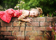 Girl on a wall ({amanda}) Tags: overgrown girl wall kids child mykid 85mm overcast naturallight commercial 6years sixyears amandakeeysphotography