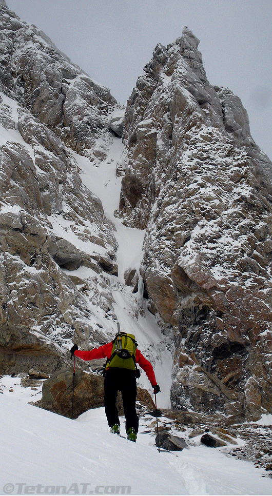 Steve skins in front of Molar Tooth Couloir