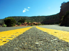 Dangerous Curves Ahead (curious_spider) Tags: road perspective groundlevel curve asphalt doubleyellow porous coloradonationalmonument rimrockdrive
