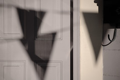 Flag Day (alankin) Tags: light 15fav abstract philadelphia nikon shadows pennsylvania d70s mostinteresting philly banners nikkor mountairy mtairy germantownavenue dccc almostmonochromatic urbandetails doordetails 75views i500 interestingness323 0800026amu niknala haphazarttriangle 55200mmf456gvr 1sep2007 dccc:comp=1102
