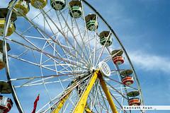 Wheel (Kenneth Kwan) Tags: blue sky canada calgary film alberta expired calgarystampede kodakgold200 gold200 vuescan konicaminoltadimagescandualiv yashicaiclynx5000e kennethkwan