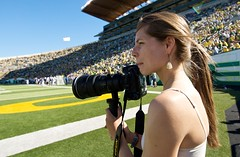 The next shot (Daniel Bachhuber) Tags: camera summer portrait people field oregon football nikon afternoon outdoor stadium candid crowd sunny eugene thinking shooting footballgame universityoforegon photographing oregonducks oregondailyemerald autzenstadium directlight taylorschefstrom