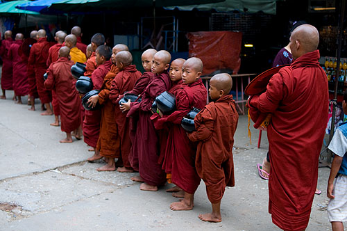 Monks doing the morning alms walk, Thachilek, Shan State, Myanmar