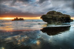 Shipwrecked rock (Mark Emirali) Tags: ocean sunset sea newzealand sun storm colour reflection rock clouds canon landscape waves front nz tamron aotearoa hdr 30d copyrighted canon30d portwaikato pleasedonotusewithoutmypermission damniwishidtakenthat maloe4 nz101portwaikato maloephoto maloephotography markemirali markemiraliphotography