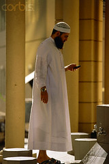 UAE Muslim Brother (Muslim Friend) Tags: city travel people men outdoors reading 1 clothing shoes sandals telephone islam watch religion fulllength middleeast cellphone beards mosque cap abudhabi footwear males facialhair wristwatch adults contrasts unitedarabemirates urbanscenes textmessaging arabs headgear telecommunications telephoning midadult midadultman capitalcity nationalcapital traditionalclothing middleeasterners persiangulfstates dialing 4045years 40sadult abuzaby