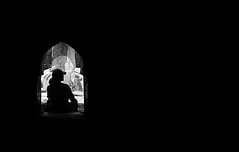 silhouette (lightonmymind) Tags: blackandwhite bw india man monument silhouette delete10 delete9 delete5 delete2 interestingness sitting arch delete6 delete7 save3 delete8 delete3 delete delete4 save save2 negativespace cap humanyunstomb
