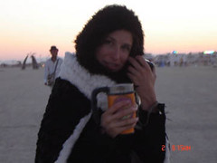 HeartSong Marla - Marla enjoys some hot brew from her stylish Double Shot in Black Rock City.