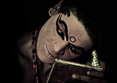 Kathakali Dancer Applying Make-up, Kochi, India (Eric Lafforgue) Tags: music india art tourism scale face canon mirror democracy dance eyes dancing indian makeup kerala dancer indie collar miroir indi cochin indien tamil hind kochi indi miror inde 1019 kochin hodu kathakali southasia indland  hindistan 3200iso indija   ndia hindustan   lafforgue   ericlafforgue hindia  theatricalperformance bhrat kathakalidancing  indhiya bhratavarsha bhratadesha bharatadeshamu bhrrowtbaurshow  hndkastan