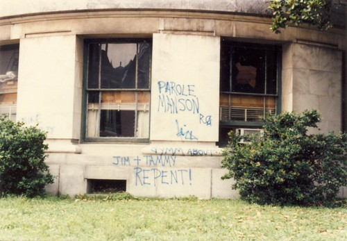 abandoned building somewhere in New Orleans with graffiti: Parole Manson