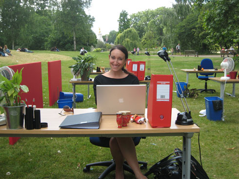 Alicia at her desk in the park
