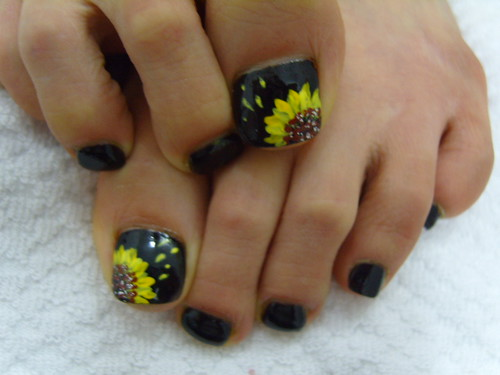 Sun Flowers over black toe nails paintingg art design.