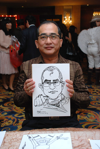 Caricature live sketching for Temasek Holdings D&D 2008 Hero Night 2
