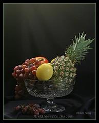Fruit Bowl (middleearthimages) Tags: life red black apple yellow still lemon crystal bowl pineapple grapes gren 15challengeswinner
