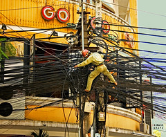 Saigon. Electrician at work (gilmarcil) Tags: wire asia cable chi asie ho minh saigon gilles hcmc hochiminh electrician marcil inspiredbylove hcmv lectricien gillesmarcil