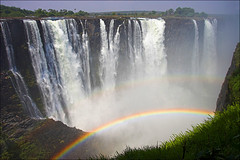 ... over the rainbow (AnyMotion) Tags: africa travel nature water waterfall reisen wasser wasserfall zimbabwe afrika victoriafalls 2008 naturesfinest anymotion zambeziriver 50faves mosioatunya landschaftsaufnahmen mywinners abigfave flickrdiamond ysplix theunforgettablepictures theperfectphotographer multimegashot reflectyourworld phvalue
