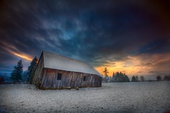 Sunrise Barn (Jeff Engelhardt) Tags: ranch morning blue trees winter sunset orange snow abandoned grass clouds barn rural photoshop sunrise canon landscape early twilight decay farm rustic neglected wideangle scene gas gasstation worn weathered 1022mm hdr highdynamicrange photomatix 40d