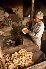 Ladakh-536 (Kelly Cheng) Tags: travel people food india man color colour male men heritage tourism vertical bread daylight colorful asia market culture vivid indoor bakery colourful persons bazaar himalaya leh himalayas jk ladakh subcontinent jammukashmir kashmirjammu lpbread
