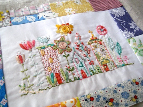 bloom sampler finished up in patchwork frame