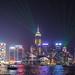 Hong Kong city skyline at night over Victoria Harbor
