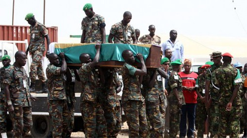 Soldiers in Sudan carry a coffin of a fallen member.