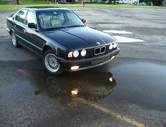 washoo5 (Josiah S.) Tags: reflection puddle parkinglot bmw e34 525i